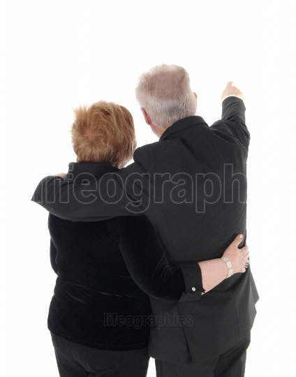 Senior couple standing from back