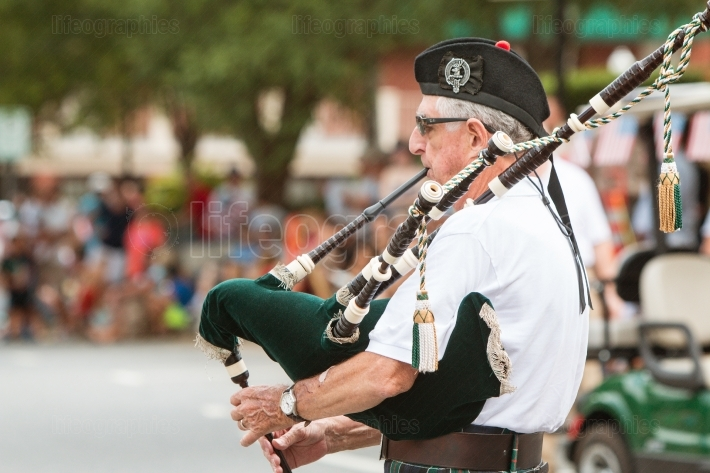 Senior Man Plays Bagpipes Before Old Soldiers Day Parade