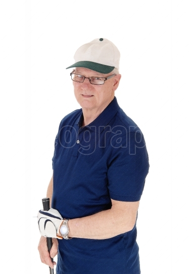 Senior man standing with golf hat