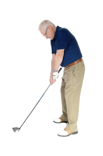 Senior practicing golf at home