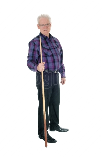 Senior standing with billiard cue