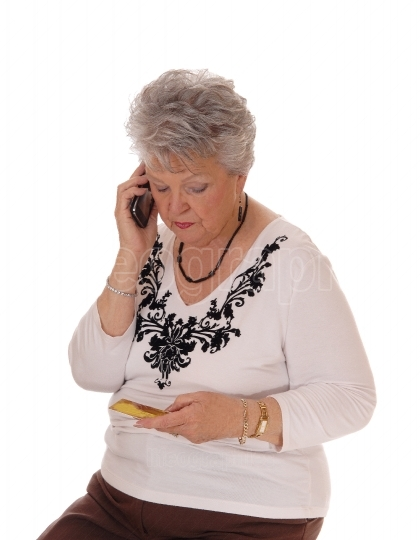 Senior woman buying over phone.
