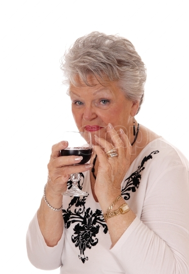 Senior woman holding a glass of wine.