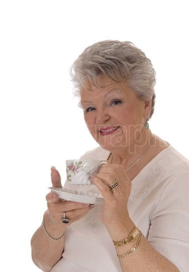 Senior woman holding coffee cup.