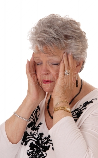 Senior woman holding her head for headache.
