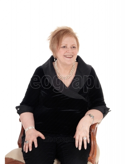 Senior woman relaxing in armchair