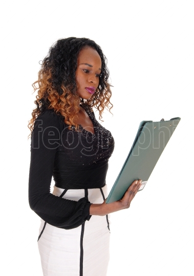Serious woman reading her paper.