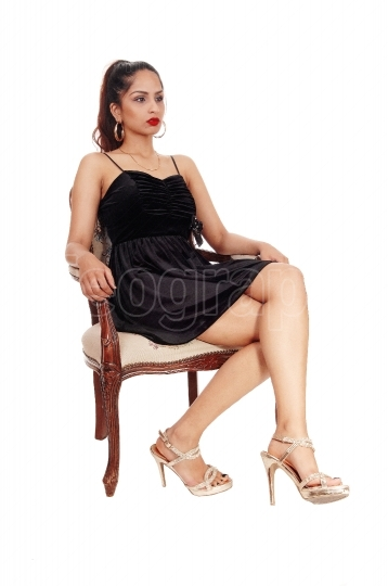Serious woman sitting on old armchair