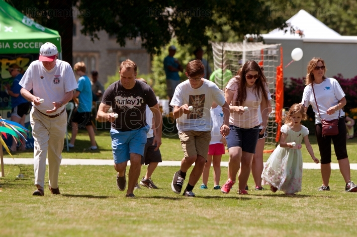 Several People Compete In Egg And Spoon Race At Festival
