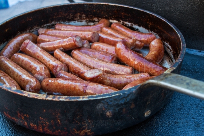 Several Sausages Cook In Vintage Frying Pan