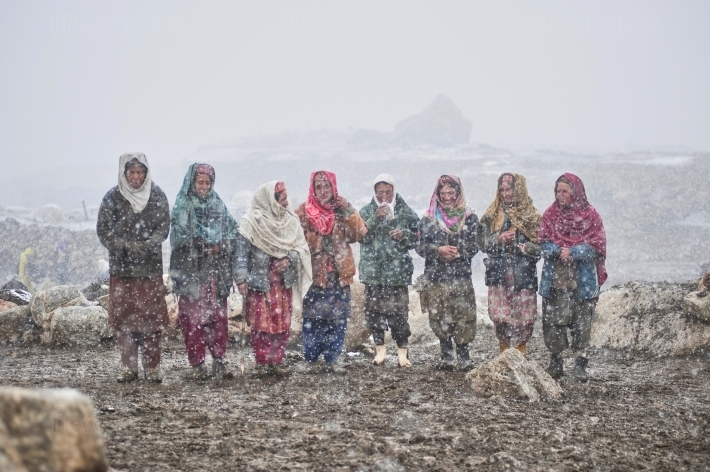 Shimshal women expecting the returning of yaks to start milking