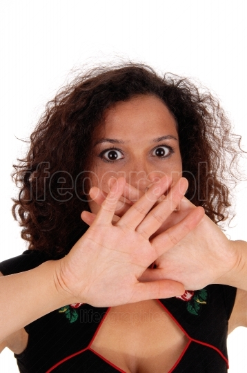 Shocked woman with hand over mouth.
