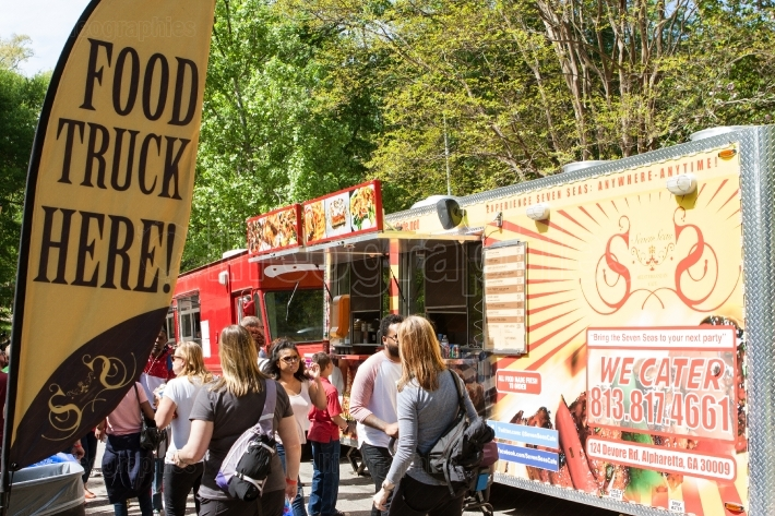 Sign promotes presence of food trucks at atlanta festival