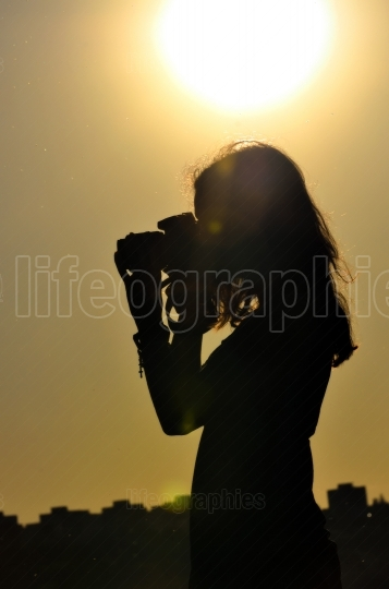 Silhouette of girl in shooting time