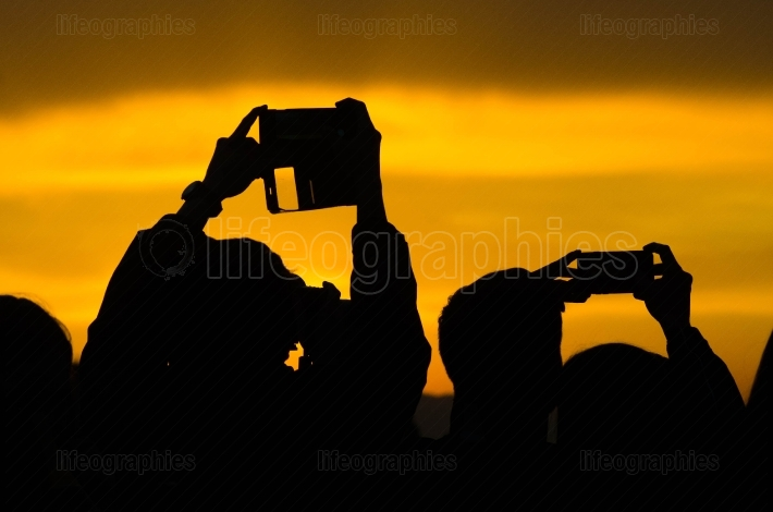 Silhouette with people with phone and camera taking photos