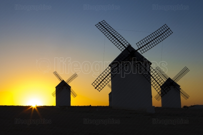 Silhouettes of traditional windmills at Campo de Criptana site,