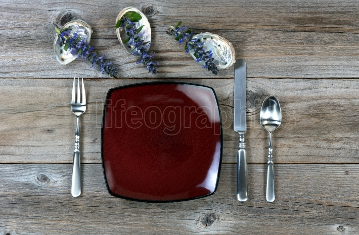 Simple dinner and silverware setting along with nature decoratio