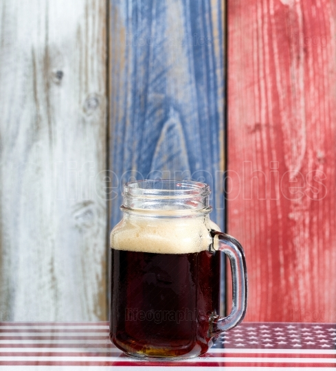 Single beer with faded wooden boards painted in USA national col