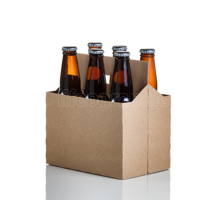 Six pack of glass bottled beer in generic brown cardboard carrie