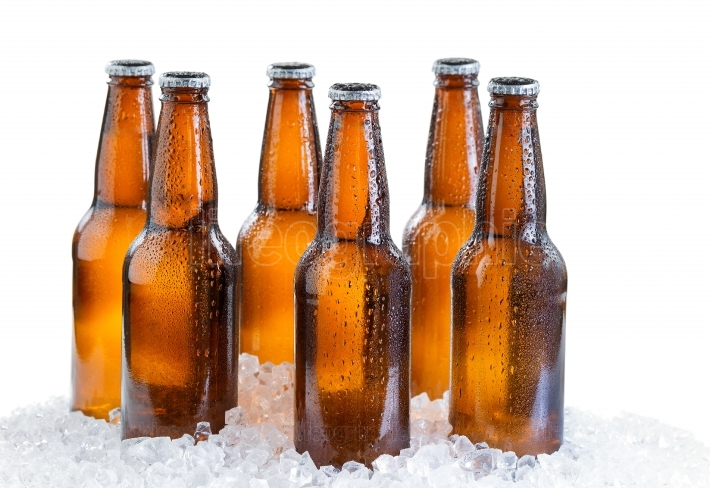 Six pack of ice cold bottled beer isolated on white background