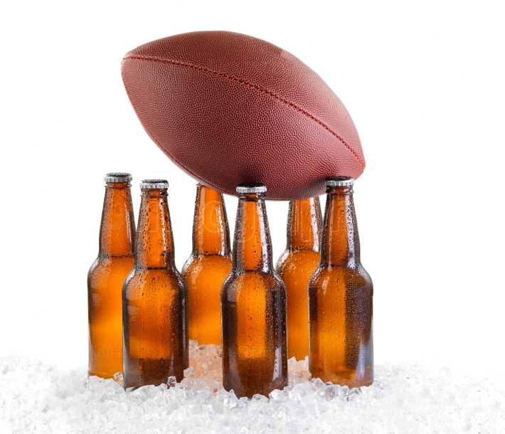 Six pack of ice cold bottled beer with American football isolate