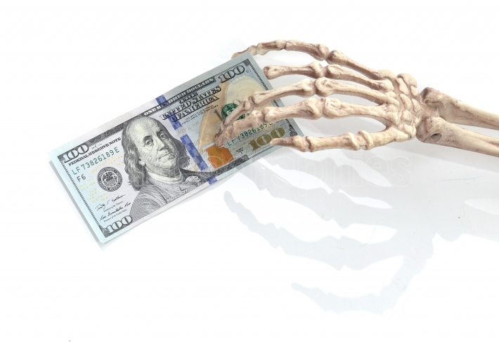 Skeleton hand with money