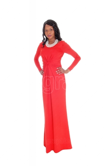 Slim African American woman long red dress.