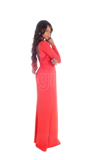 Slim African American woman red dress.