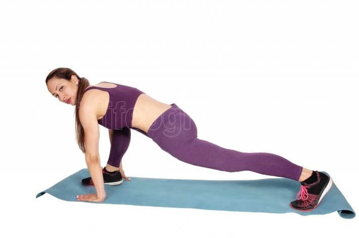 Slim woman stretching her body