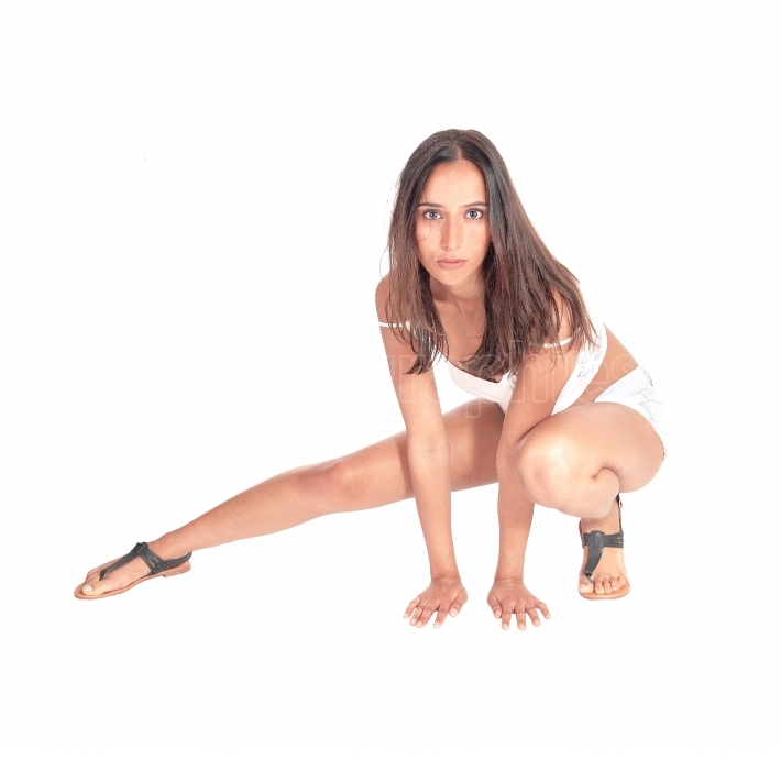 Slim young woman crouching on the floor
