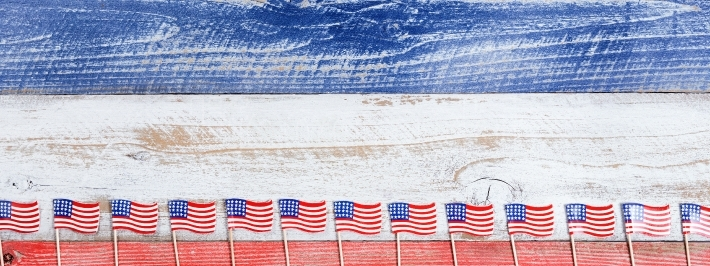 Small USA flags on bottom of rustic boards with national colors