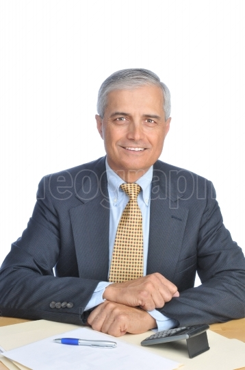 Smiling Businessman Seated at Desk