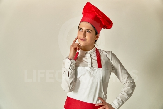 Smiling female chef or baker