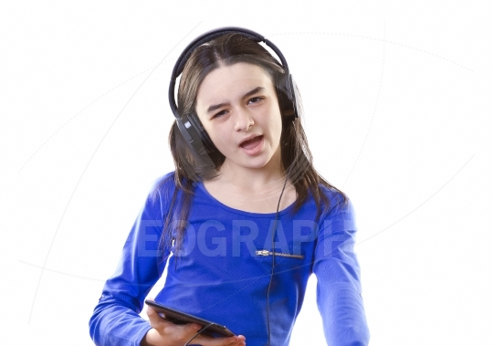 Smiling girl listening to music on digital tablet pc