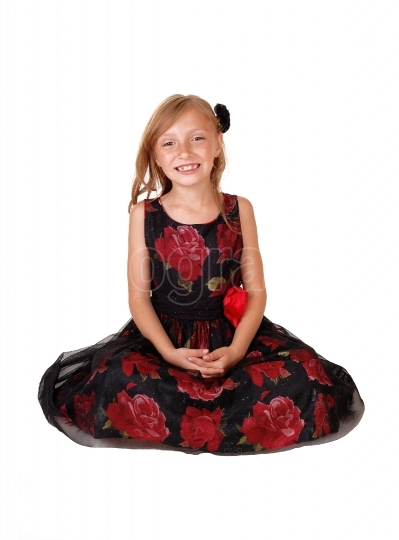 Smiling girl sitting on floor