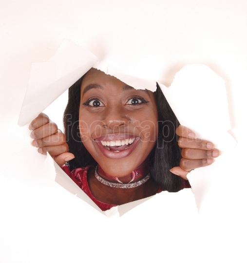 Smiling woman looking trough hole