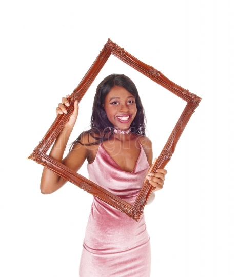 Smiling woman looking trough picture frame