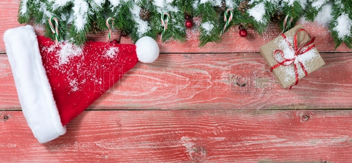 Snowy rustic red wooden boards with Christmas decorations