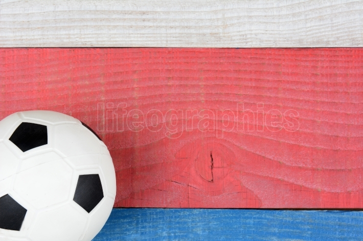 Soccer Ball on Red, White and Blue Table