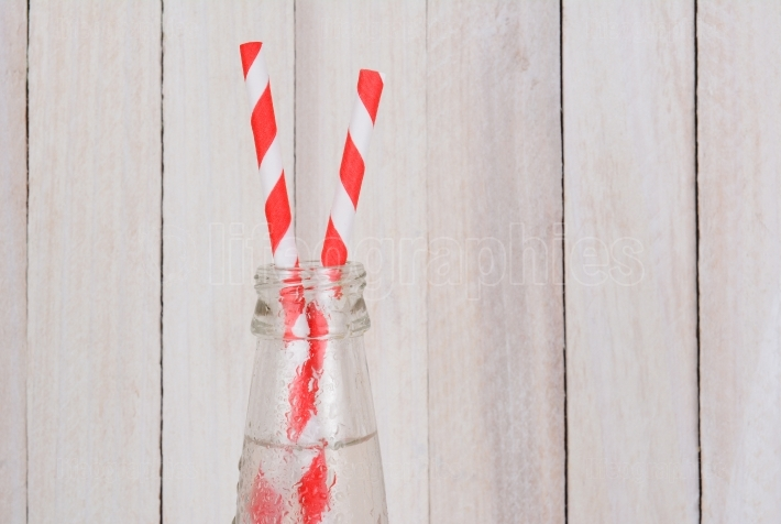 Soda Bottles and Two Straws