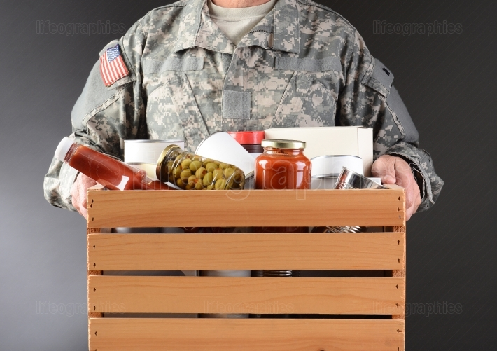 Soldier Holding Food Drive Box