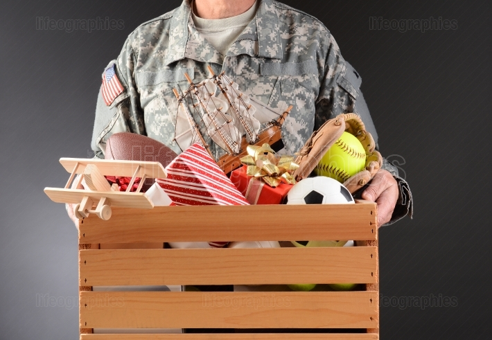 Soldier Holding Toy Drive Box