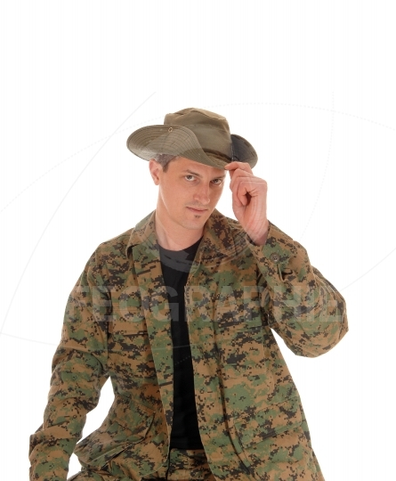 Soldier in uniform and hat..