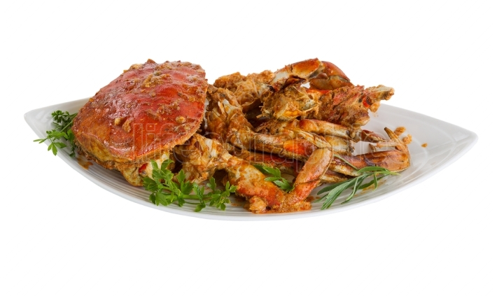 Spicy cooked crab ready to serve on white background