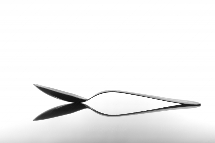 Spoon on glossy table surface