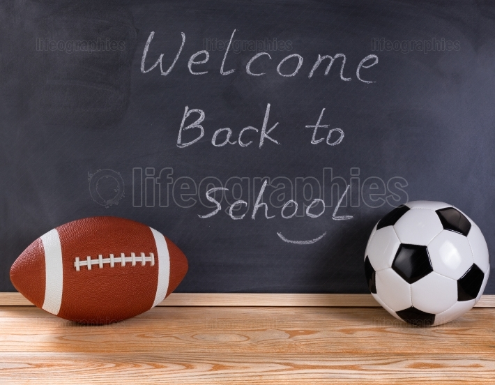 Sports equipment with black chalkboard in background