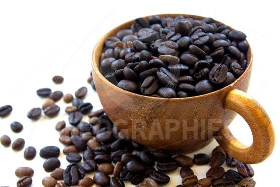 Spread coffee seeds isolated on white background
