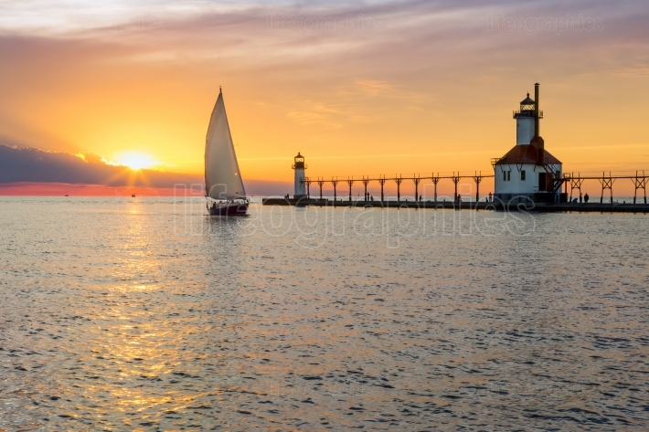 St  Joseph Lighthouse and Sailboat Solstice Sundown