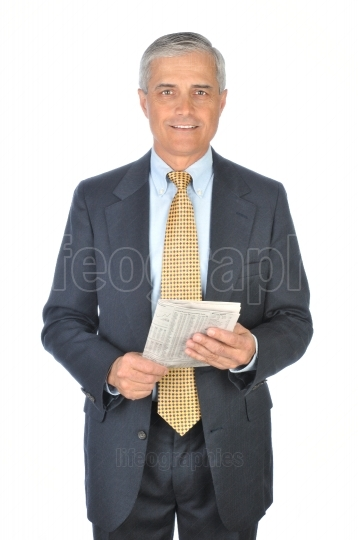 Standing Businessman with Financial Section