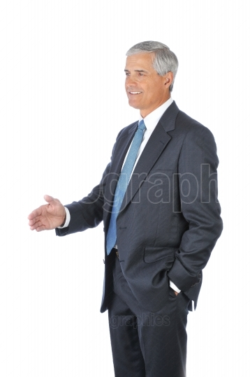 Standing Businessman with hand extended to shake